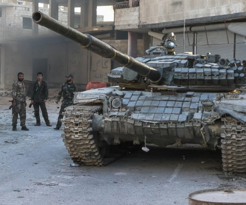 Assad's regime takes back strategic Syrian town from Islamic State