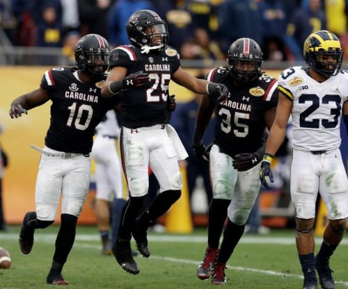 Outback Bowl: South Carolina Gamecocks rally past Michigan Wolverines