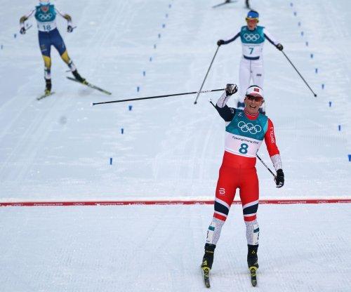 Norway's Bjoergen equals Winter Olympics medal record of 13 in Pyeongchang