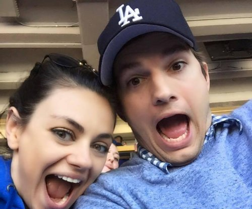 Ashton Kutcher, Mila Kunis snap silly selfie at Dodgers game