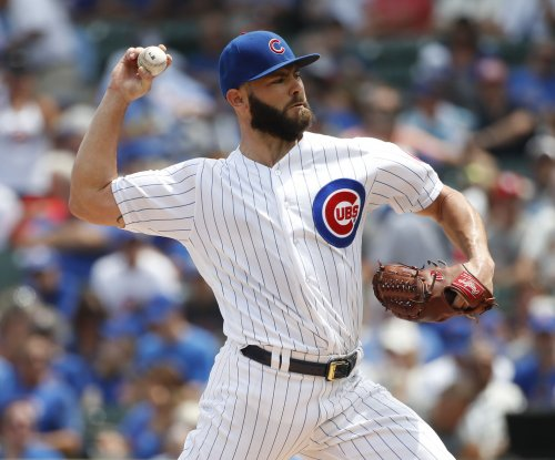 Jake Arrieta's pitching, Javier Baez's inside-the-park HR spark Chicago Cubs