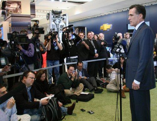 Romney, reporter spar on lobbyist claim