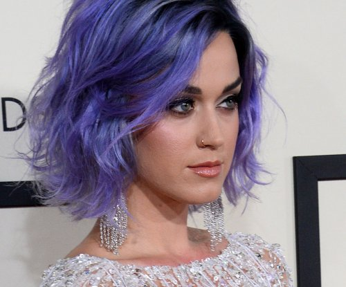 Katy Perry solemn in Grammy's anthem for domestic violence survivors