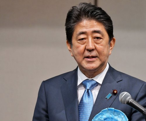 Japan PM Abe orders breakup of parliament, snap election next month