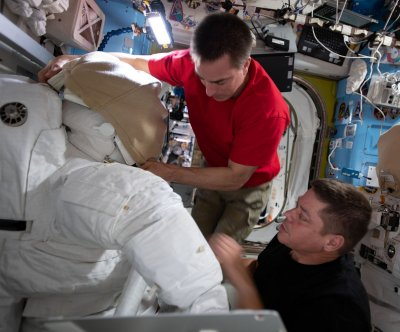Watch live: Astronauts begin spacewalk to replace batteries at ISS