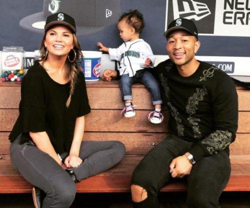 John Legend, Chrissy Teigen help daughter throw first pitch