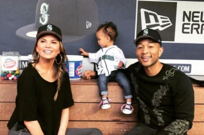 John Legend, Chrissy Teigen help daughter throw first pitch