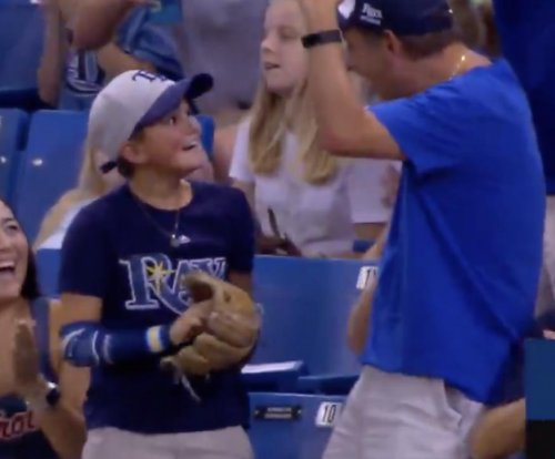 Boy catches homer at Rays game, can't stop smiling