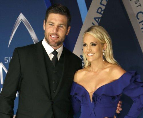 Carrie Underwood celebrates wedding anniversary: 'Here's to 8 years'
