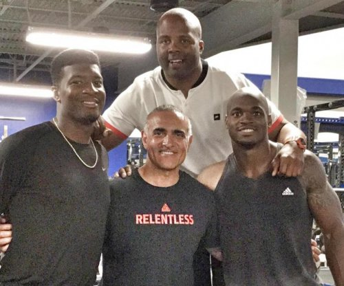 Adrian Peterson works out with Jameis Winston