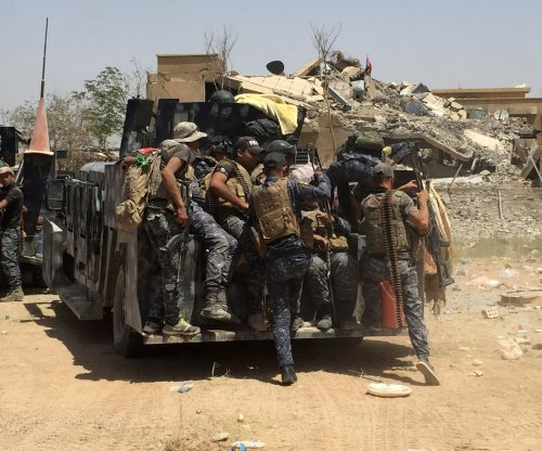Islamic State retakes air base day after U.S.-backed rebels took control