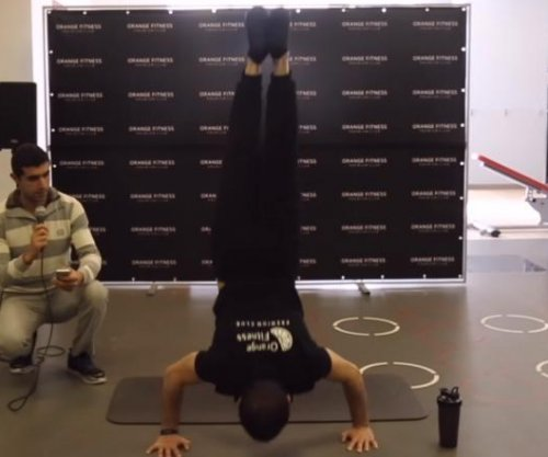 Fitness buff sets Guinness record for handstand push ups