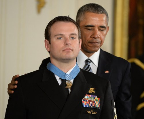 Navy SEAL receives Medal of Honor for 2012 rescue of American from Taliban