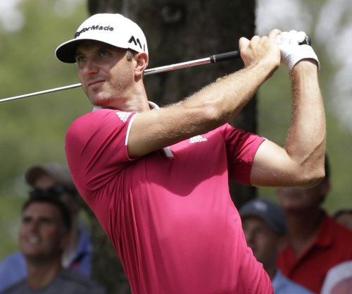 Dustin Johnson fires 67, leads Tour Championship by 1