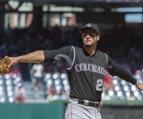 Rockies' Arenado to return for opener vs. Cubs