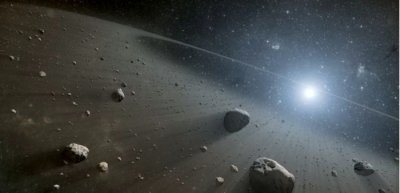 Asteroids at distant star suggest planets