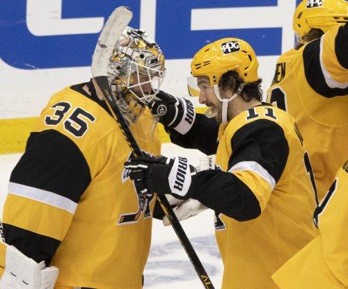 Penguins, goalie Tristan Jarry hold off Islanders, even NHL playoff series