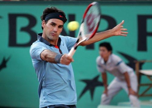 Federer escapes with five-set win