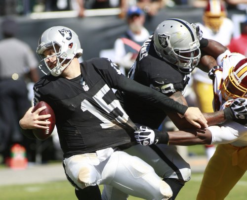 Raiders release quarterback Matt Flynn after losing job to Pryor