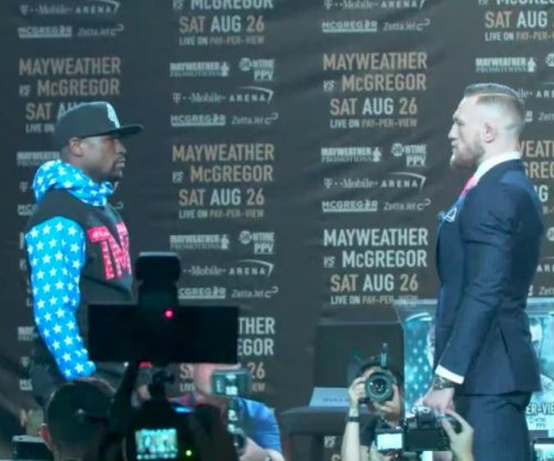 Traveling Floyd Mayweather, Conor McGregor promotion show opens with fireworks