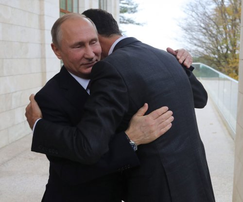 Putin welcomes surprise visit by Assad in prelude to peace talks