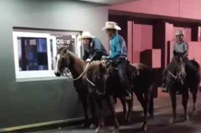 Cowboys take their horses through KFC drive-through