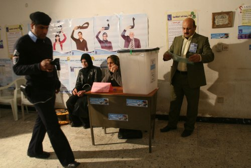 Election centers targeted in Iraq as police and military cast votes in first parliamentary election since U.S. forces withdrew