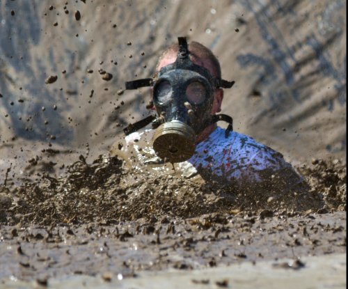 1,000 people possibly sickened by fecal matter in French mud run