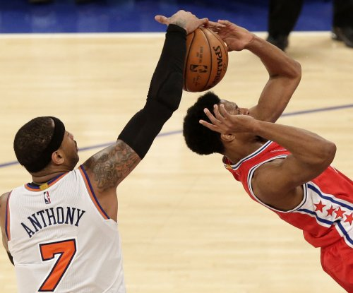 Carmelo Anthony returns as New York Knicks drop Philadelphia 76ers in double OT
