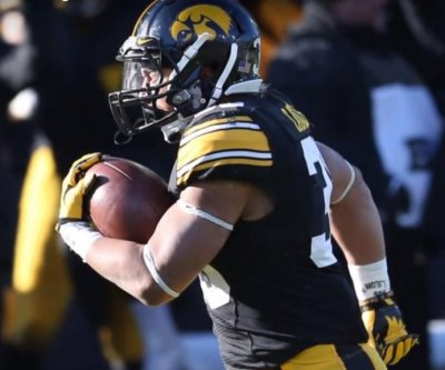 Unbeaten Iowa, surging Oklahoma debut in College Football Playoff top four