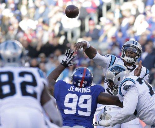 Carolina Panthers tamp New York Giants' late rally, hit 14-0