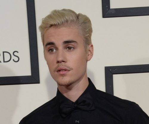 Justin Bieber declares he's 'done' taking photos with fans