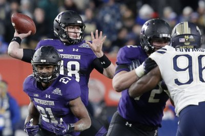 Northwestern upsets No. 16 Michigan State in 3OT