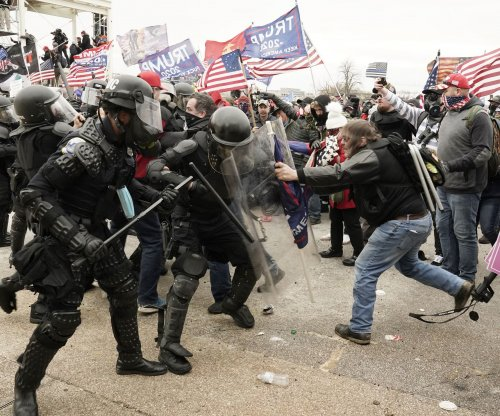 Capitol rioter accused of beating officer to be jailed until trial
