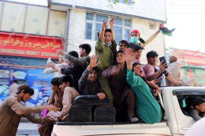 , Afghanistan activists clash with Taliban for 2nd day; President Joe Biden vows to get U.S. evacuees out, Forex-News, Forex-News