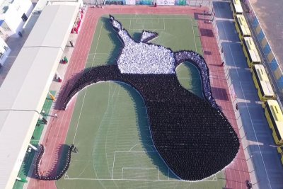 Students form image of coffee pot for two Guinness records