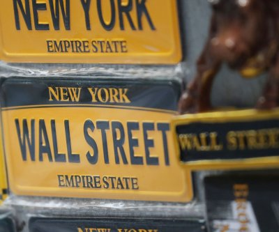Dow drops 222 points as U.S. COVID-19 cases rise, Caterpillar stock falls