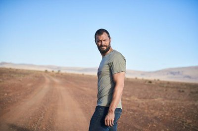 Jamie Dornan drives a lonely road in first 'The Tourist' photos