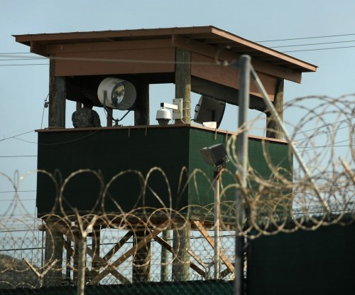U.S. transfers 15 inmates at Guantanamo in push to close prison during Obama presidency