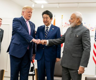 Japan's Shinzo Abe postpones India summit amid violence