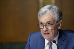 Fed plans two interest rate hikes by the end of 2023; Dow falls 265 points