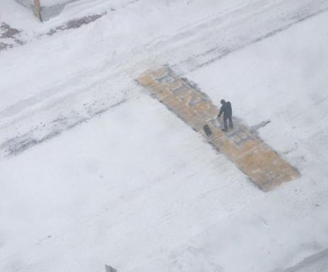 Who shoveled snow from the Boston Marathon finish line during the winter storm?