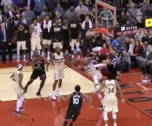 Raptors make crazy buzzer-beater dunk, but lose in OT