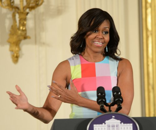 Michelle Obama encourages Oberlin College graduates to hold elected office