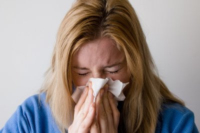 Flu numbers continue to fall but remain high