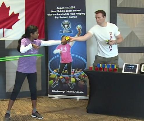 Girl, 11, solves 30 Rubik's cubes one-handed while hula hooping