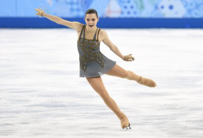 Russian defeats defending champ for figure skating gold