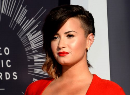 Demi Lovato says excercise helps her mood