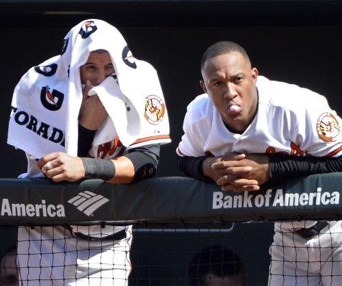 Manny Machado powers Baltimore Orioles past Oakland Athletics in extras