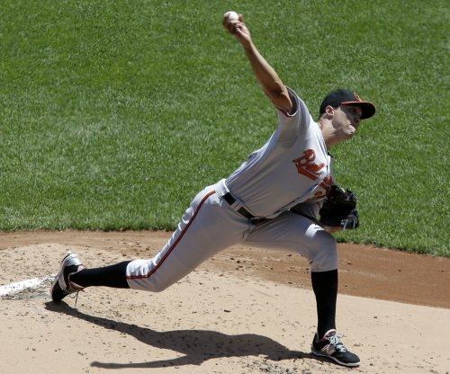 Ubaldo Jimenez rebounds in Baltimore Orioles' win over Cincinnati Reds